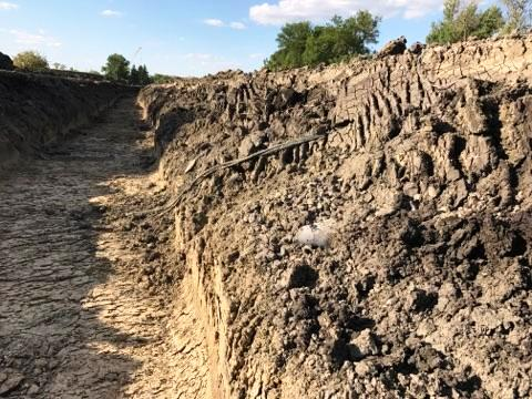 Image #5 - Power Cables and Drain Pipe in Base of Dike Levee - Oxbow, ND